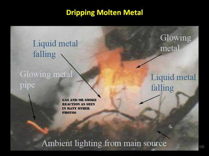 Almost-six-weeks-after-911-molten-metal-was-dripping-from-heavy-equipment-as-WTC-debris-was-being-picked-up-from-ground-zero.jpg